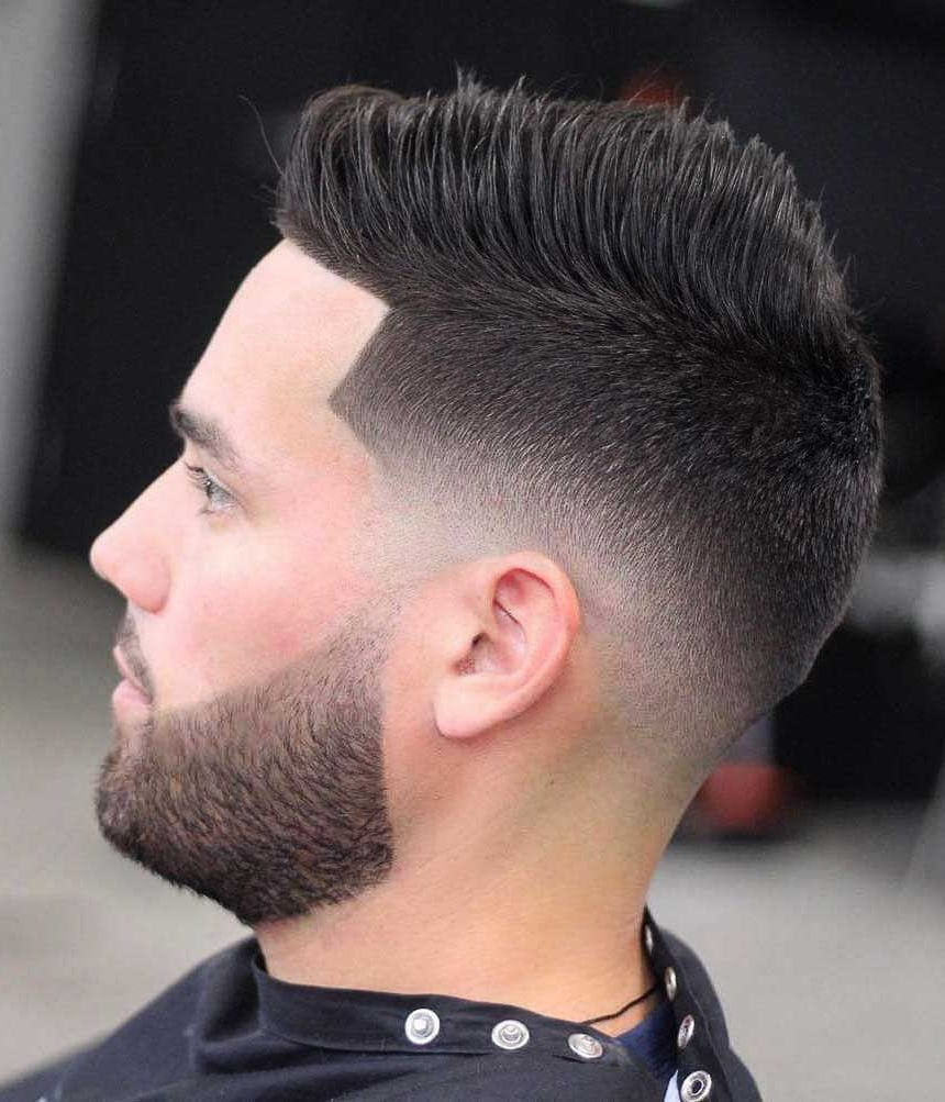 a low skin fade with a line up and a beard is a chic idea to wear