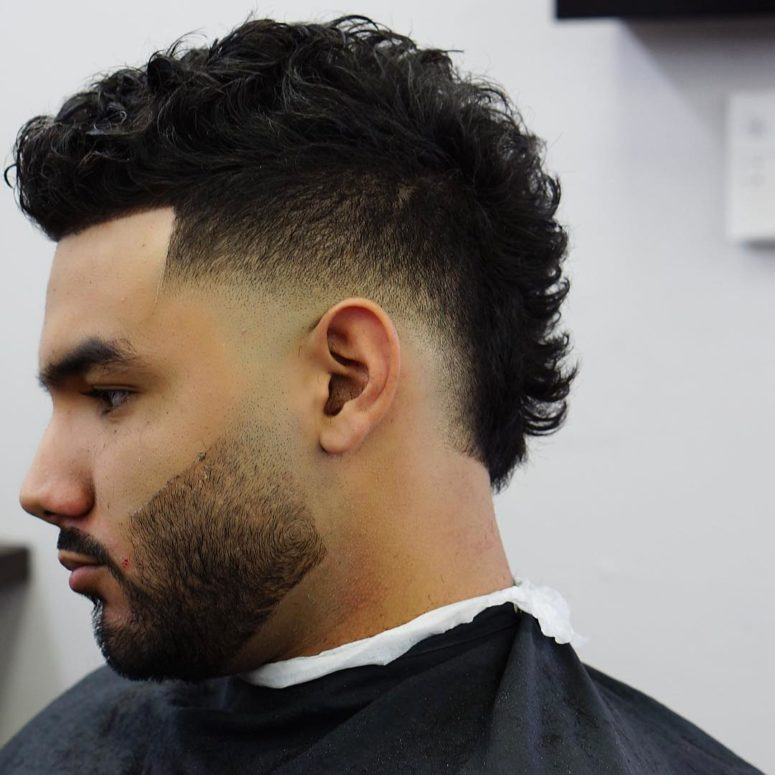 a mohawk fade on curly hair requires minimal effort to style and works no less cooler than with straight hair
