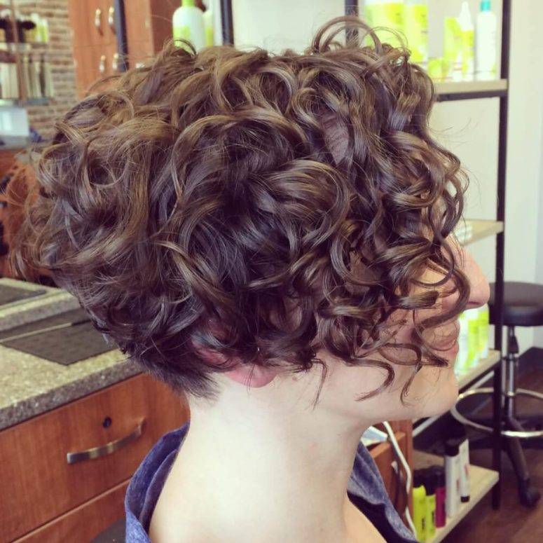 a naturally curly angled short bob doesn't require much maintaining and looks dimensional