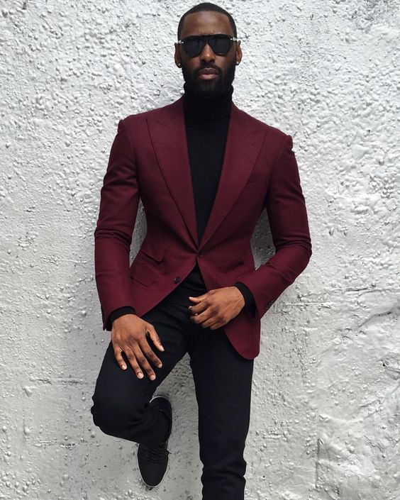 a total black outfit with a plum colored blazer to add a touch of holiday color