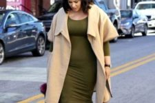 04 an olive green knee dress with long sleeves, green tall boots, a neutral sleeveless coat and a fuchsia bag