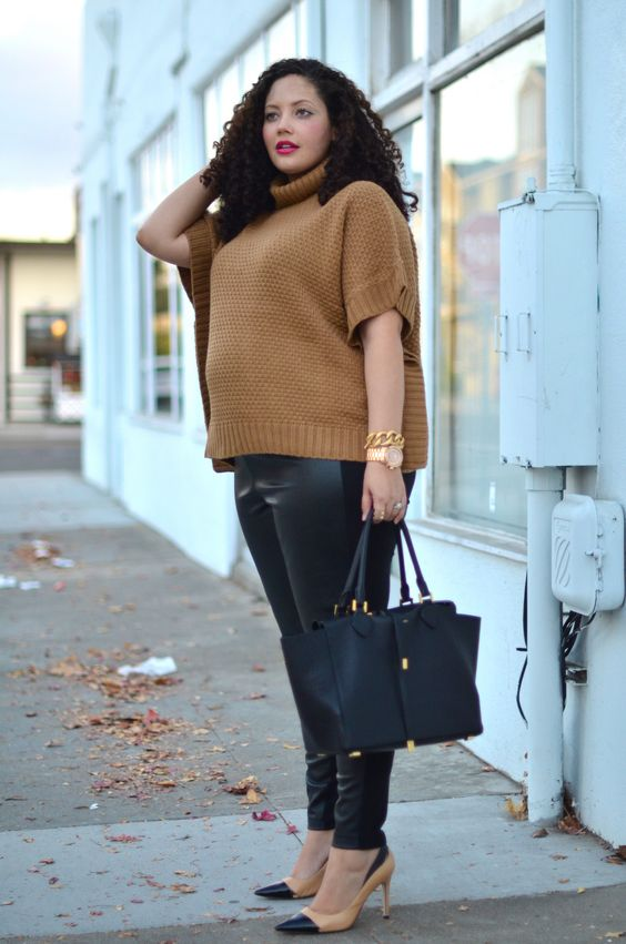 black leather leggings, a tan colored turtleneck sweater with short sleeves, tan and black shoes and a black bag