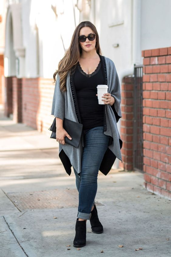 blue cuffed jeans, a black top with a lace trim, black ankle boots and a grey and black coverup