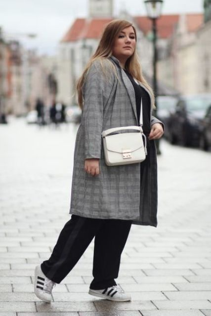 a black pantsuit, a white shirt, black and white sneakers and a grey plaid coat for a casual work look