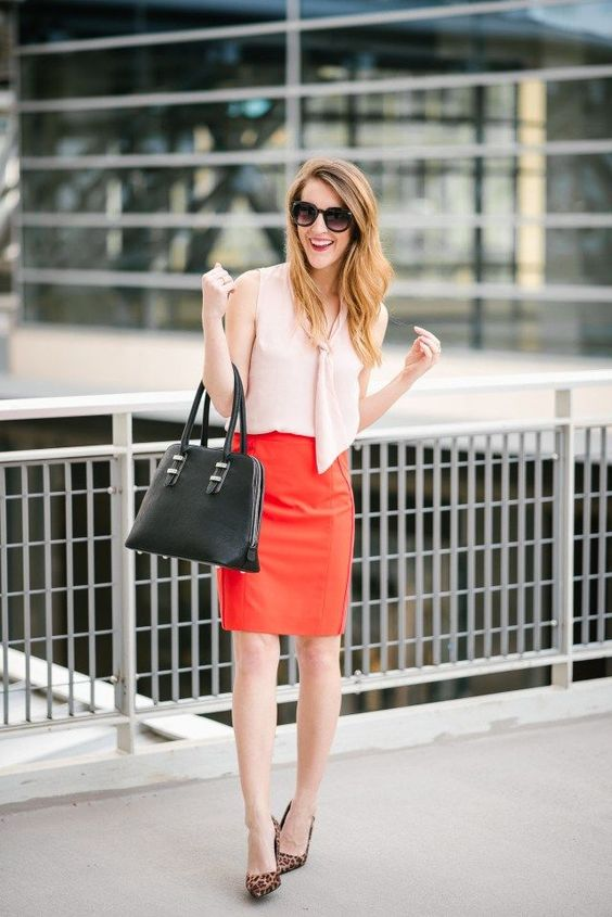 a blush top, a red over the knee skirt, leopard shoes and a black bag for a stylish color block look