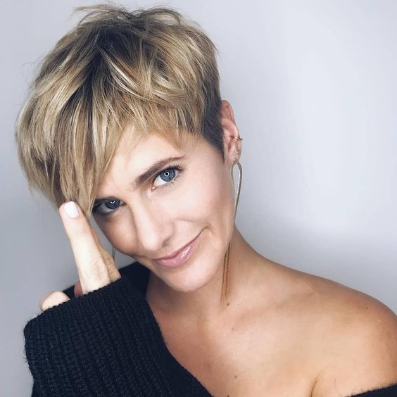 a chic and edgy layered pixie haircut with blonde balayage is very refreshing and young-looking