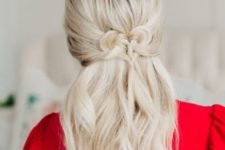 05 a cute half updo with a twsited heart and some wavy locks down will impress