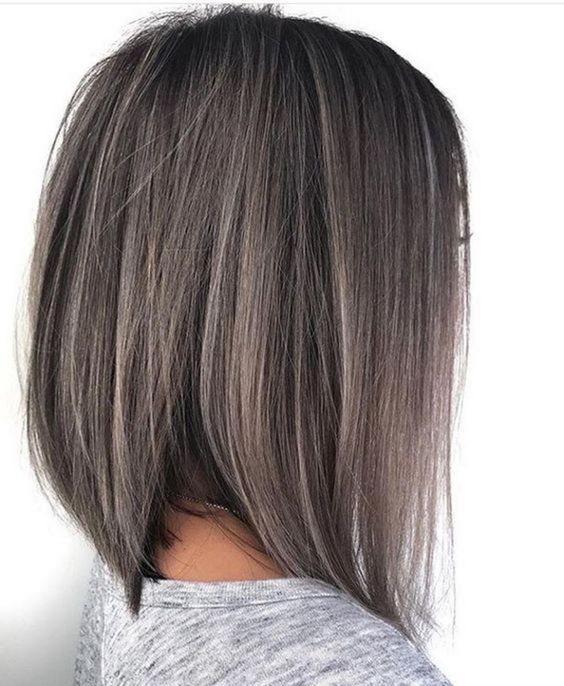 a long bob hairstyle in black with ashy brown balayage here and there