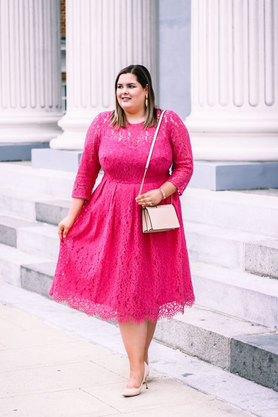 a romantic pink lace midi dress with long sleeves, a blush purse and nude heels
