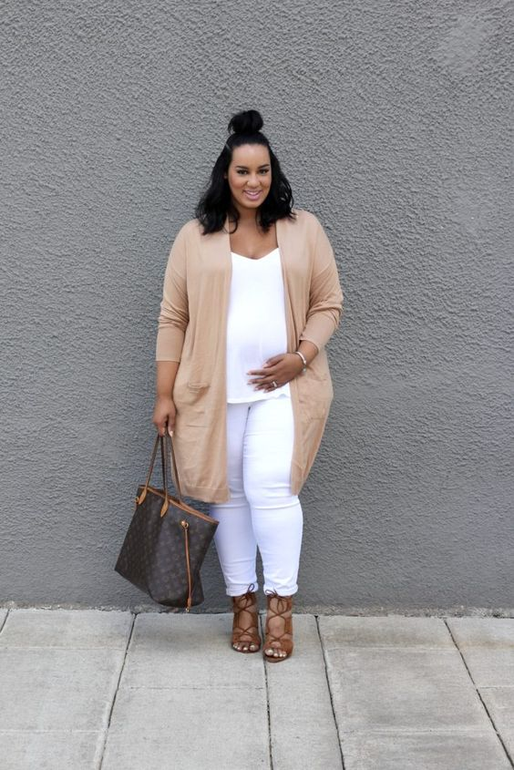 a white top and skinnies, a tan long cardigan, brown strappy shoes and a tote