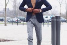 05 an elegant groom's outfit with grey pants, a mustard turtleneck, a navy blazer and brown shoes