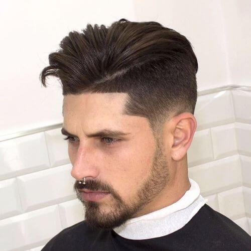 an undercut with mid fade is one of the most popular hairstyling combos