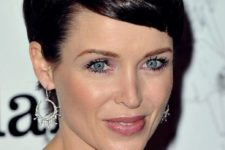 06 a chic and girlish pixie haircut with shiny dark hair is a bold statement for a wow look