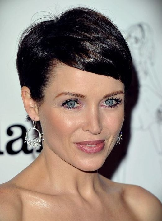 a chic and girlish pixie haircut with shiny dark hair is a bold statement for a wow look