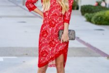 a chic red botanical print knee dress with an asymmetrical skirt, a printed clutch and creamy shoes