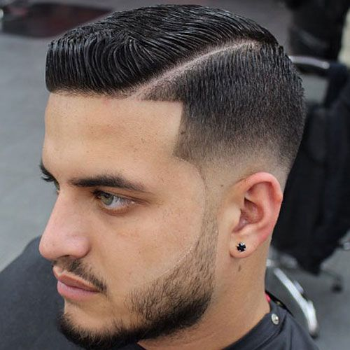 a sleek line up haircut with a fade and a beard is a cool and modern option