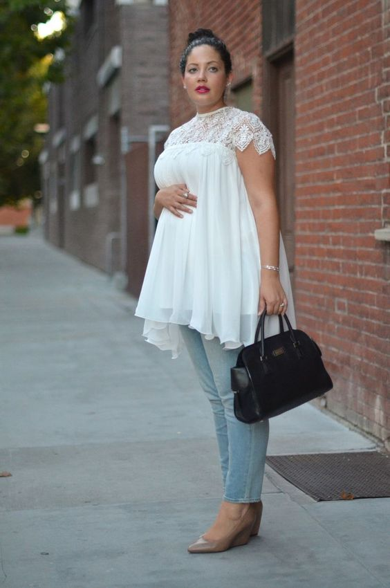 light blue jeans, a white top with a lace neckline, nude wedges and a black bag for a comfy look