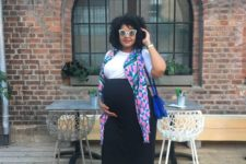 07 a black high waisted skirt, a white tee, a colorful scarf, comfy trainers and a blue bag