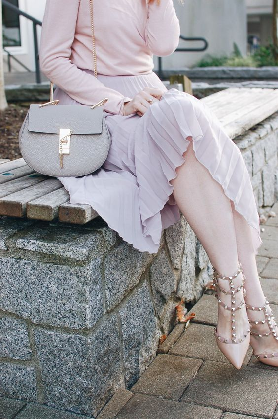a blush long sleeve top, a lilac pleated midi skirt, blush spiked shoes and a grey bag