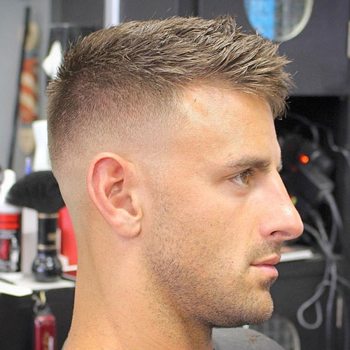 a messy textured crew cut and a bald fade is a bold and edgy option to rock right now