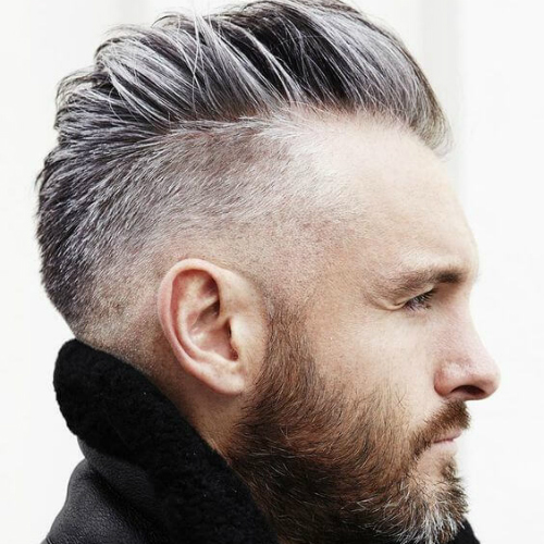 a mohawk haircut with comb over features a pompadour on top and looks softer than a usual mohawk