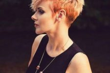 07 a textured and bold pixie haircut with a bold color and balayage is ultra-modern