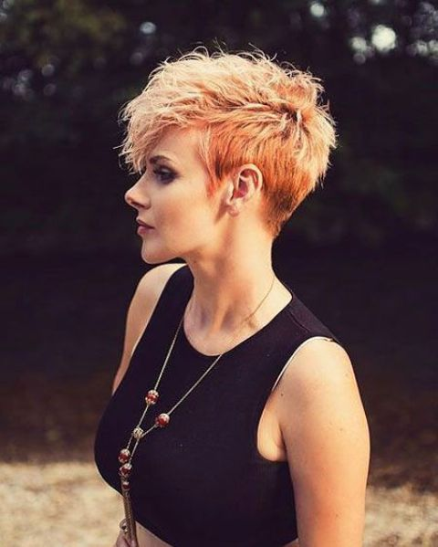 a textured and bold pixie haircut with a bold color and balayage is ultra modern