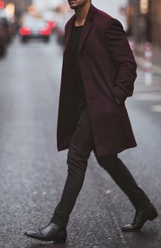 a total black look with a plum colored coat for a colorful touch