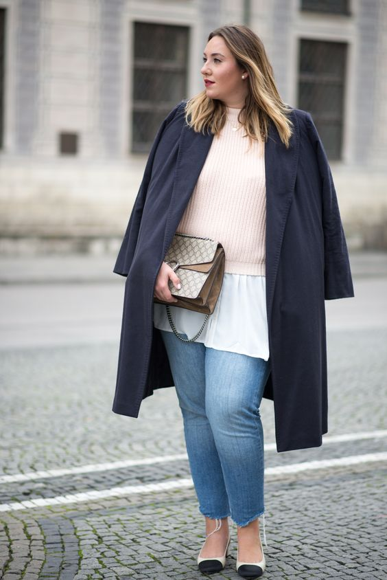 a white shirt, a blush sweater, black and white shoes, blue boyfriends and a black trench and a printed bag