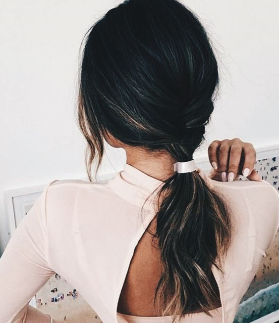 a beautiful and simple low twisted ponytail and some bangs can be made in a minute