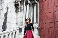 08 a black long sleeve top, a deep berry hued midi skirt and black ankle strap shoes