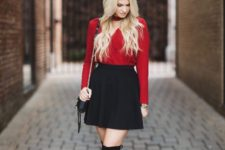 08 a black mini skirt, a red long sleeve top with a V-neckline, black tall boots and a little bag