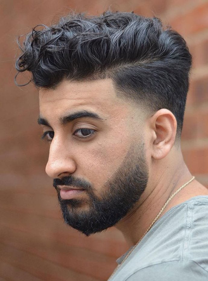 loose curly hair plus an undercut fade is a modern and fresh idea to amp up the volume