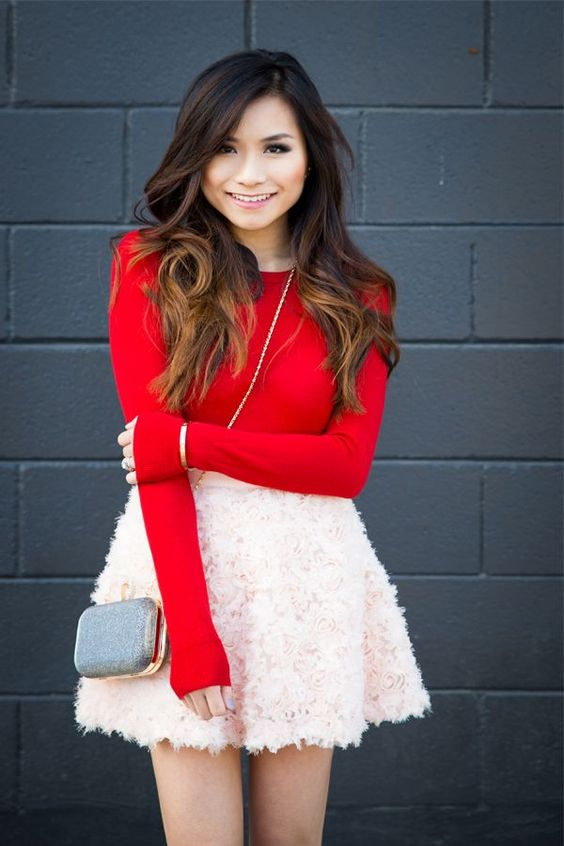 a blush rose mini A-line skirt, a red long sleeve top and a little metallic clutch