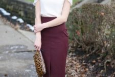 09 a burgundy pencil skirt, a white top with catchy shoulders, nude shoes and a leopard clutch
