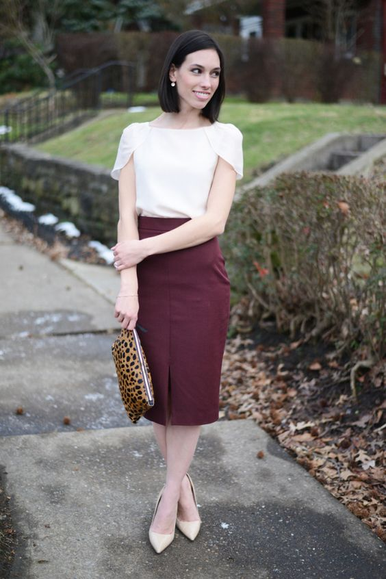 a burgundy pencil skirt, a white top with catchy shoulders, nude shoes and a leopard clutch
