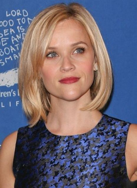 a chic short bob with side bangs is timeless elegance that always works