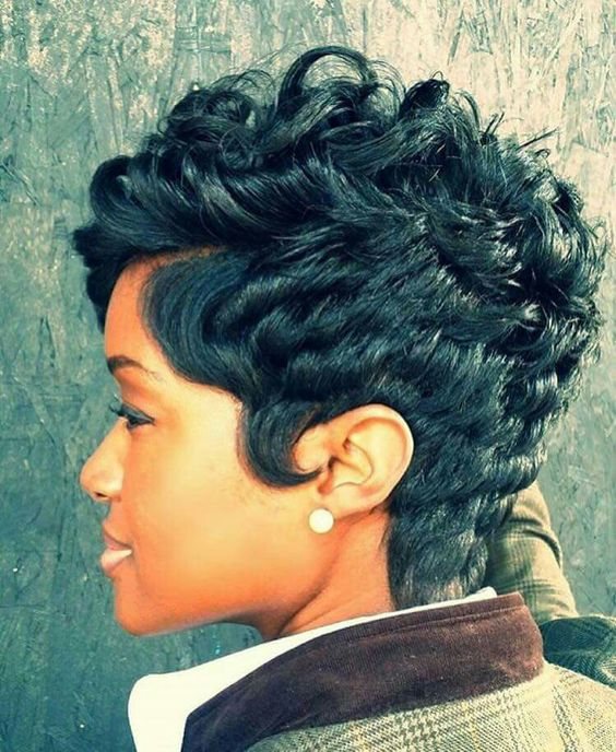 a chopped textured pixie haircut on curly hair is a timeless option that never goes out of style