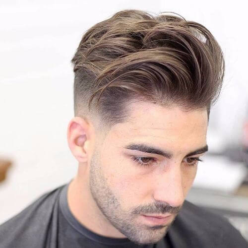 a long textured mid fade haircut is a good choice for any face shape and looks catchy and casual