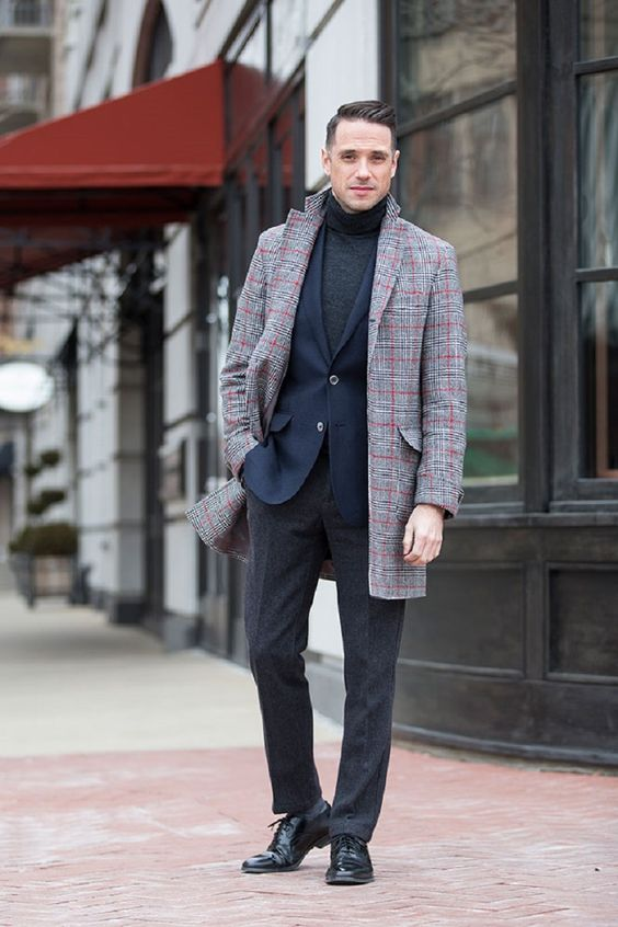 grey pants and a turtleneck, a navy blazer, black shoes and a plaid coat for a refreshing touch