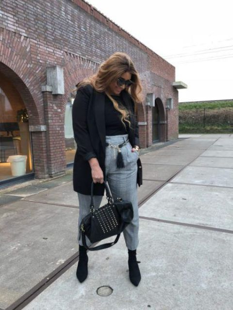 a black turtleneck, a black short coat, black sock boots and grey paid cropped pants can be worn to work