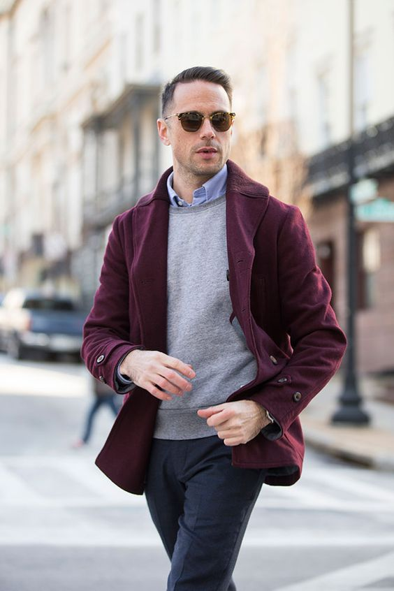 a casual look with navy pants, a blue shirt, a grey sweater and a plum-colored short coat