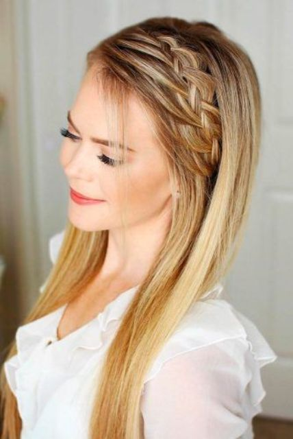 a cute hairstyle for long hair with a side braided halo and soem bangs for a relaxed feel