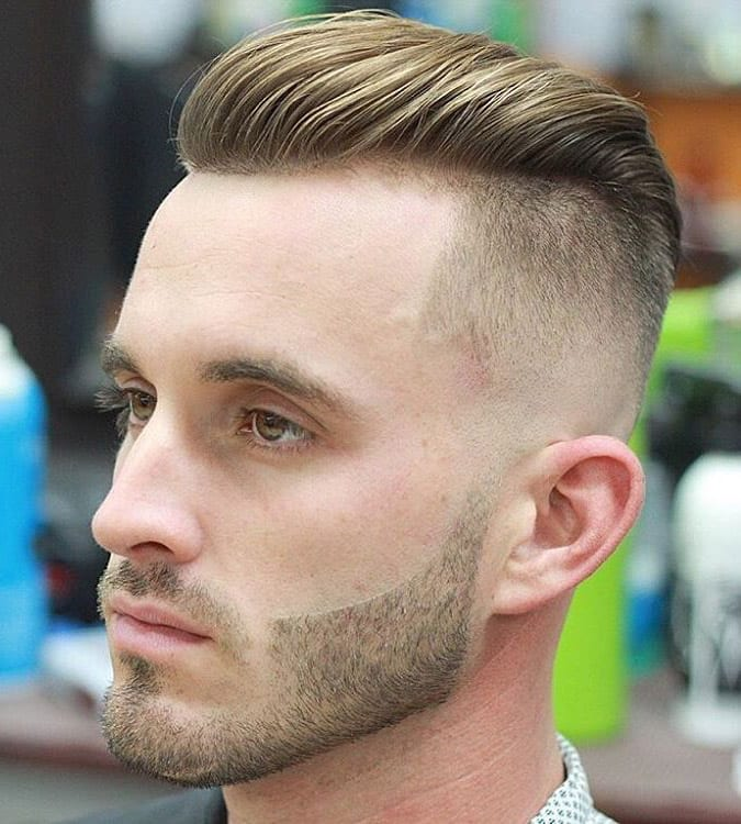 a line up undercut and a stylish beard for a modern and edgy look