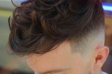 10 a textured wavy quiff and a fade is one of the hottest haircuts to rock right now