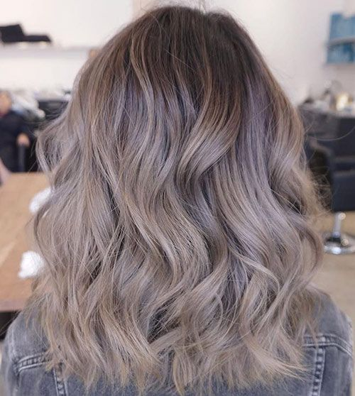 brown hair with ashy brown balayage and waves is a cool idea to imitate sunburnt locks