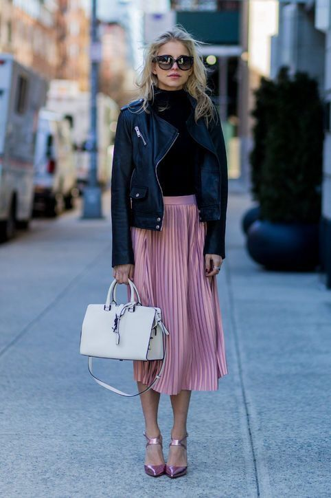 a chic and laconic look with a black turtleneck, a pink pleated midi skirt, pink metallic shoes and a black leather jacket