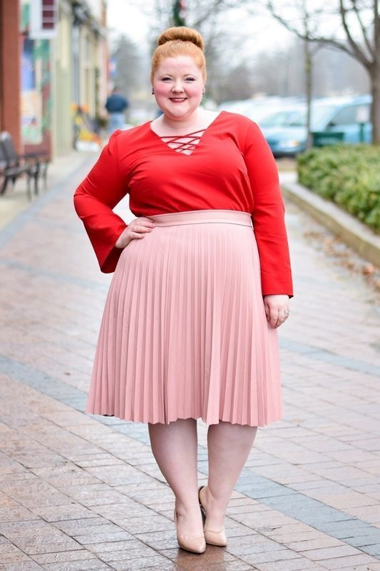 a chic look with a red long sleeve top with lacing up, a blush pleated midi and nude heels