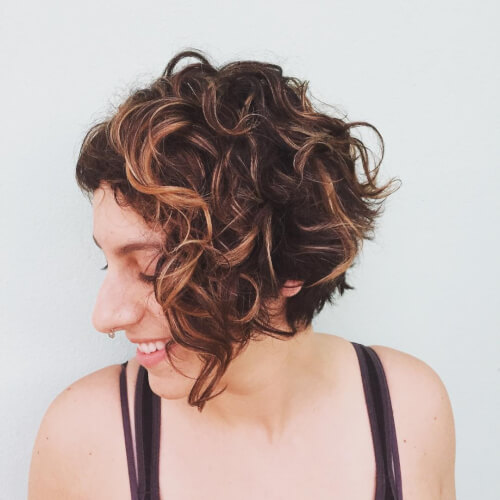 a curly inverted bob is a stylish and chic idea if you love short hair