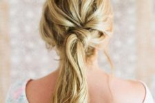 11 a fashionable twisted and messy ponytail with a messy bump for a relaxed feel
